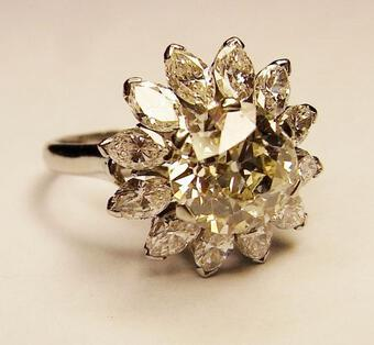 Antique A Light-fancy-yellow diamond cluster ring