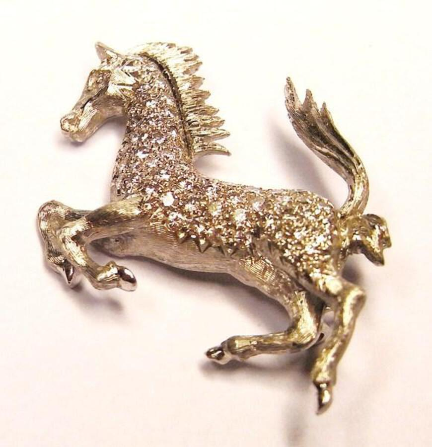 Diamond and platinum horse brooch