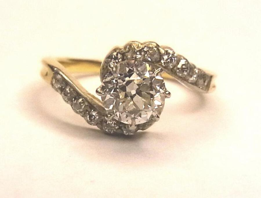 DIAMOND SOLITAIRE CROSSOVER RING