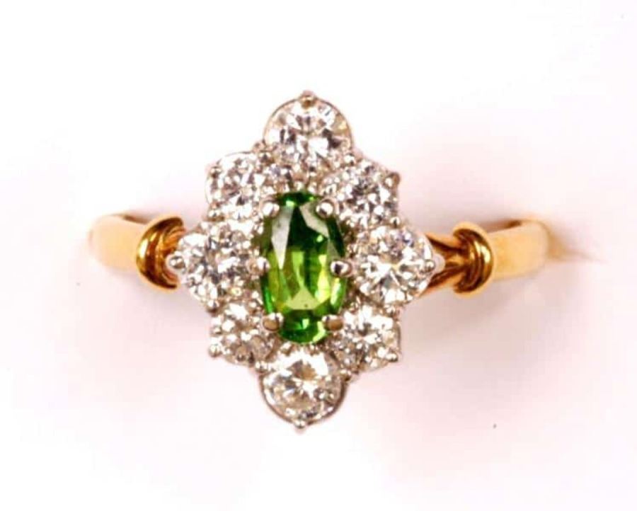 Antique DEMANTOID GARNET AND DIAMOND LOZENGE CLUSTER RING