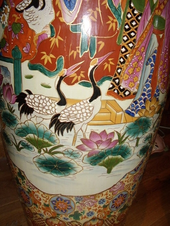 Antique A STUNNING PAIR OF 20THC.ORIENTAL ENAMELLED JAPANESE VASES MEASURING 5 FT 3 INCHES IN HEIGHT.