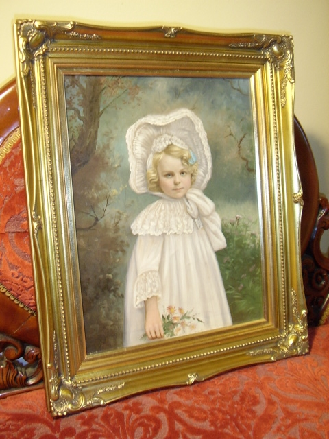 19TH.CENTURY VICTORIAN OIL ON CANVAS PORTRAIT OF A BEAUTIFUL YOUNG GIRL WEARING HER COTTON & LACE WHITE DRESS WITH BONNET TIED UNDER CHIN SEEN HOLDING FLOWERS PRESENTED IN A SWEPT GILT LATER FRAME SIZE 23.25 X 19.25 INCHES