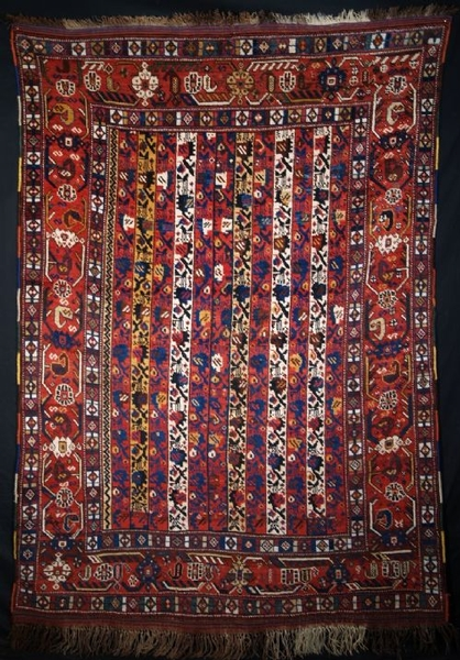 Antique ANTIQUE RUG BY THE KHAMSEH TRIBE, OF RARE DESIGN, LATE 19TH CENTURY.