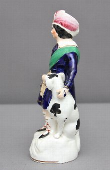 Antique Staffordshire figure of a boy and his dog