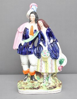 Antique Staffordshire figure of a man and woman