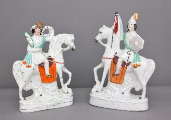 Antique A near pair of Staffordshire figures