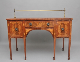 Antique Early 19th Century mahogany inlaid serpentine sideboard