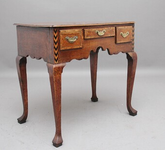 A decorative 18th Century oak lowboy