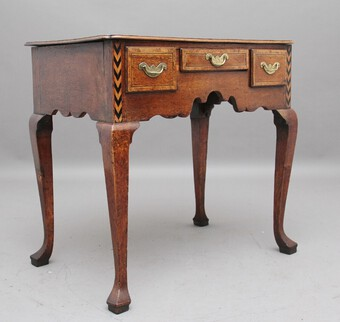 Antique A decorative 18th Century oak lowboy