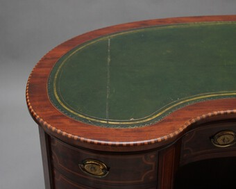 Antique 19th Century inlaid mahogany kidney shaped desk with a wonderful provenance