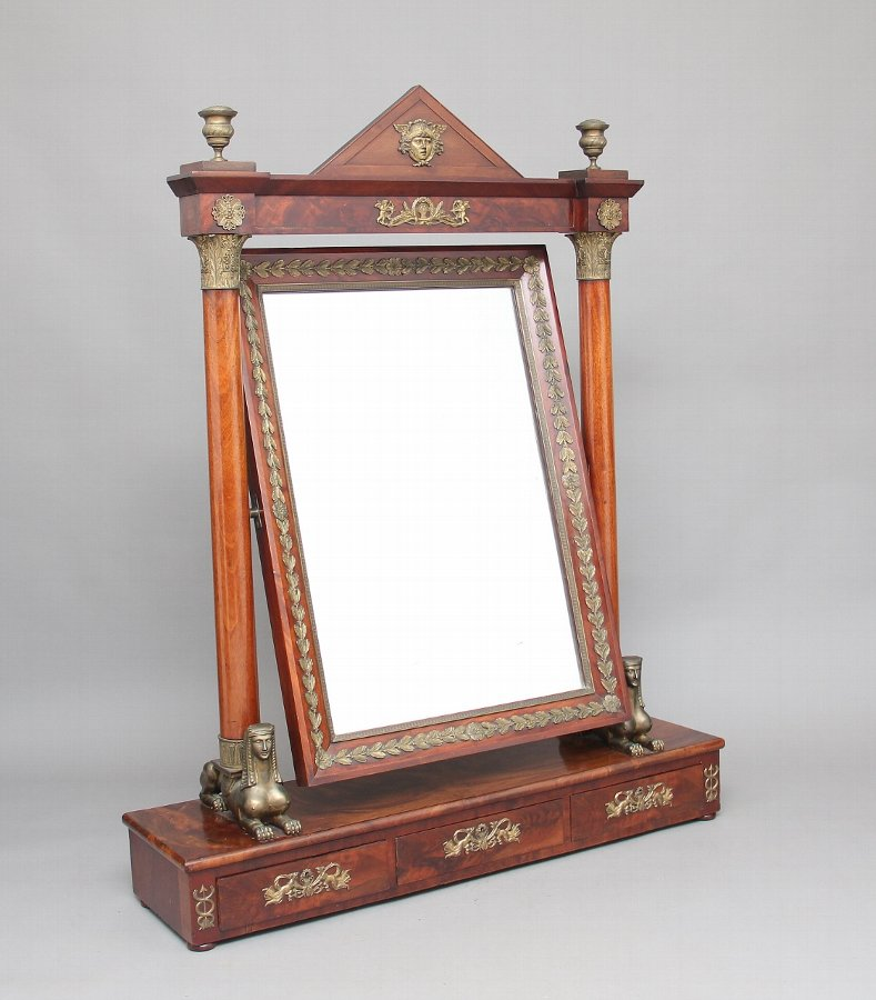 A large 19th Century French Empire dressing mirror