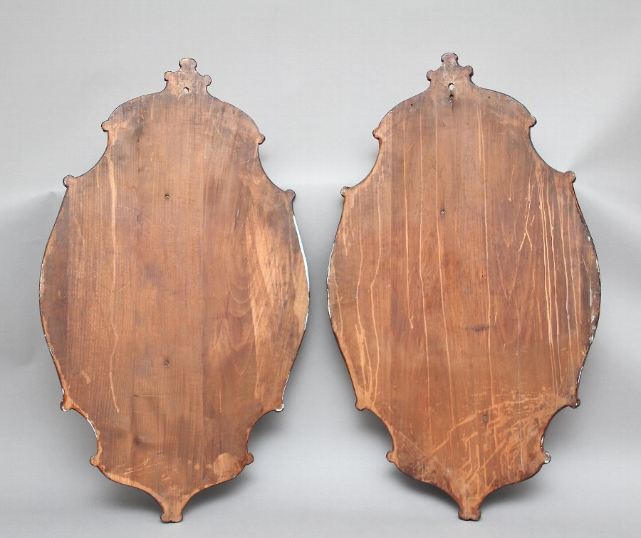 Antique A large pair of 19th Century black forest plaques