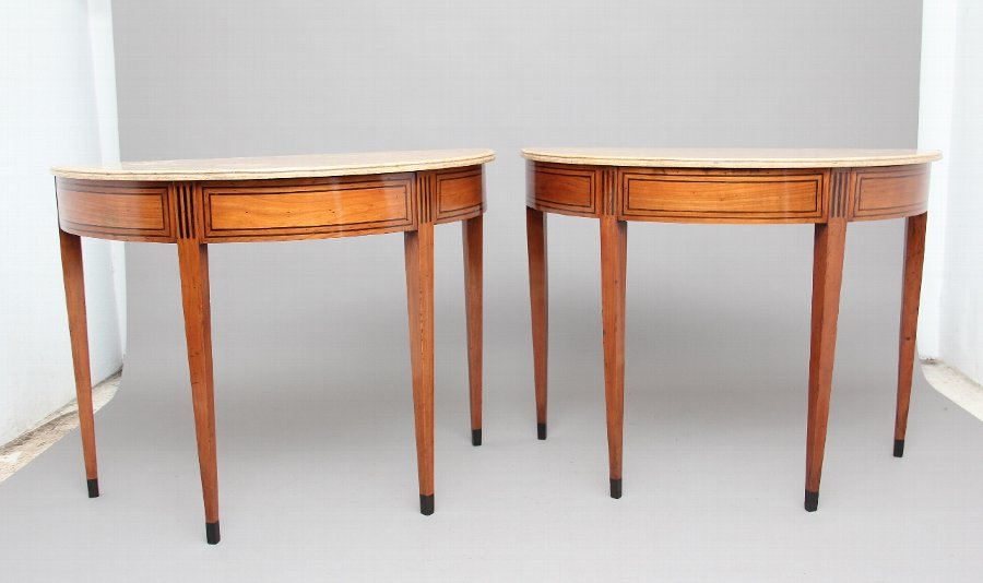 A pair of early 19th Century Italian consul tables