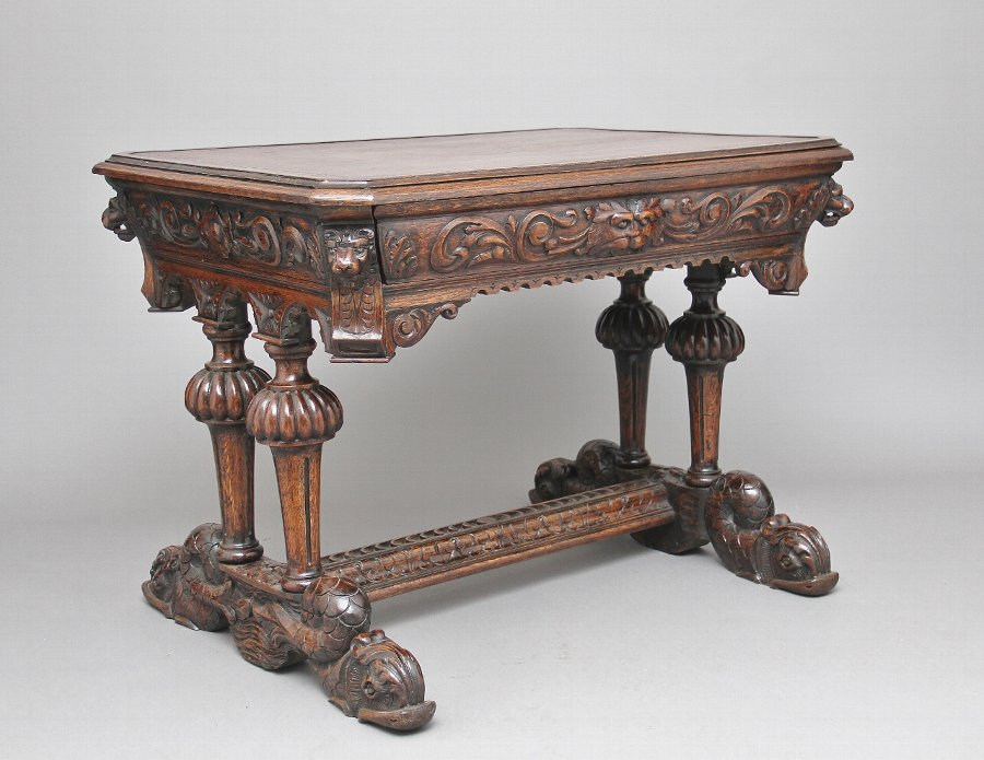 19th Century carved oak writing table
