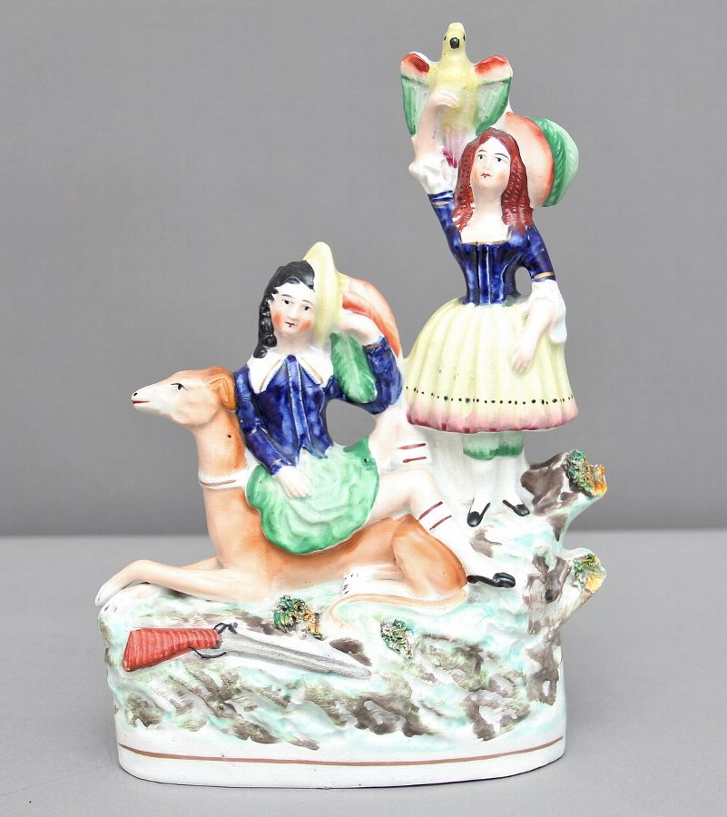 Antique Staffordshire figure of boy, girl and dog
