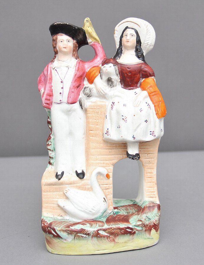 Staffordshire figure of a man, woman and swan