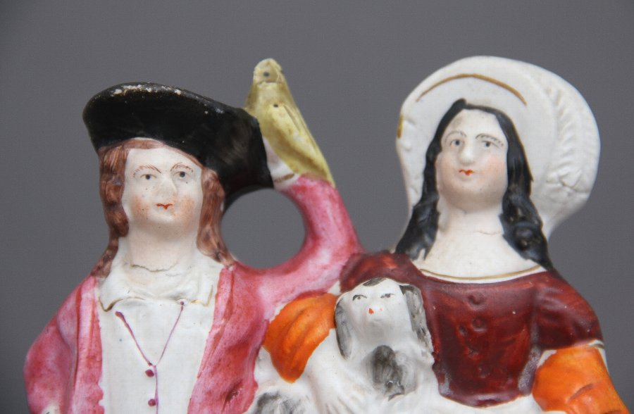 Antique Staffordshire figure of a man, woman and swan
