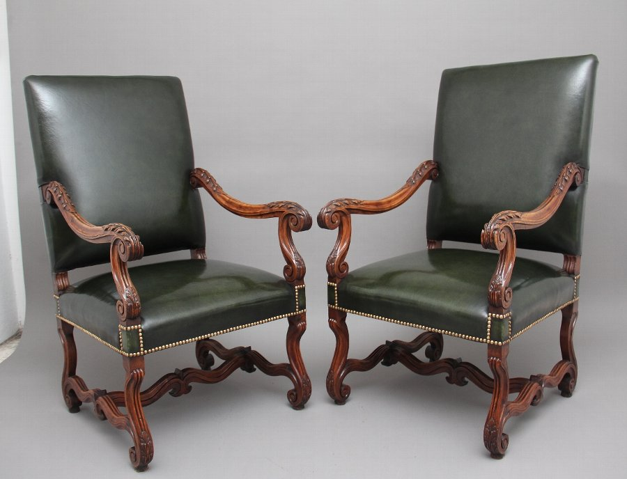 Pair of early 19th Century carved walnut armchairs
