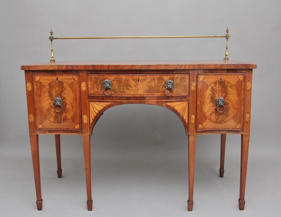 Early 19th Century mahogany inlaid serpentine sideboard