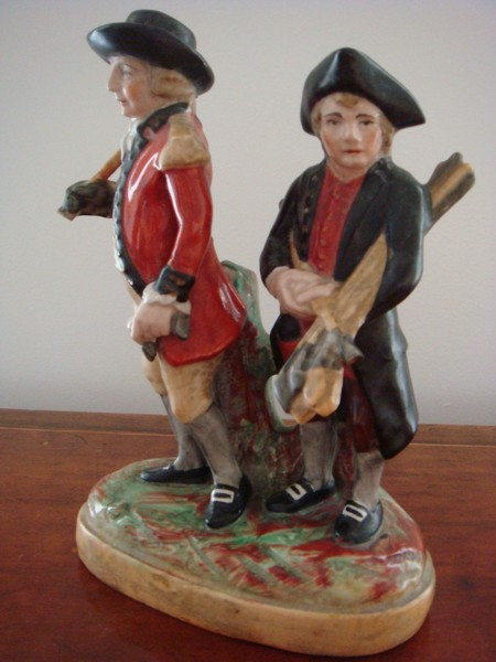 Antique Staffordshire group of golfers