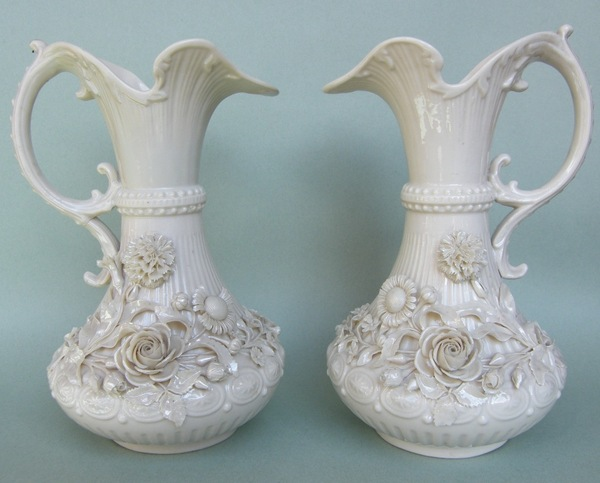 613. A Pair of Belleek China Second Period Aberdeen Jugs