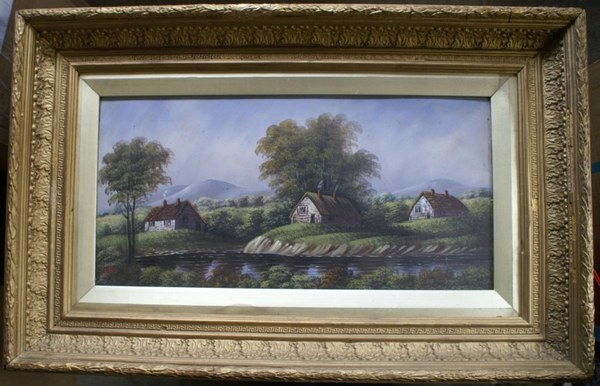 Antique A wonderful, and impressively framed and glazed, oil painting of cottages by a river.