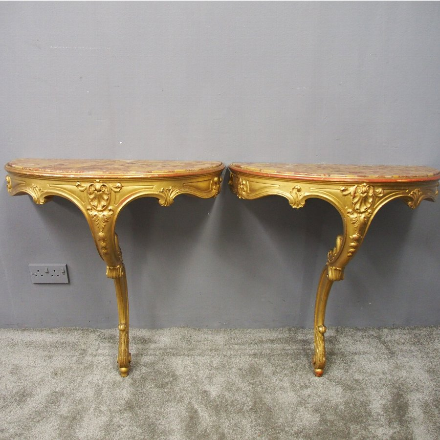Pair of Marble Top and Gilded Console Tables