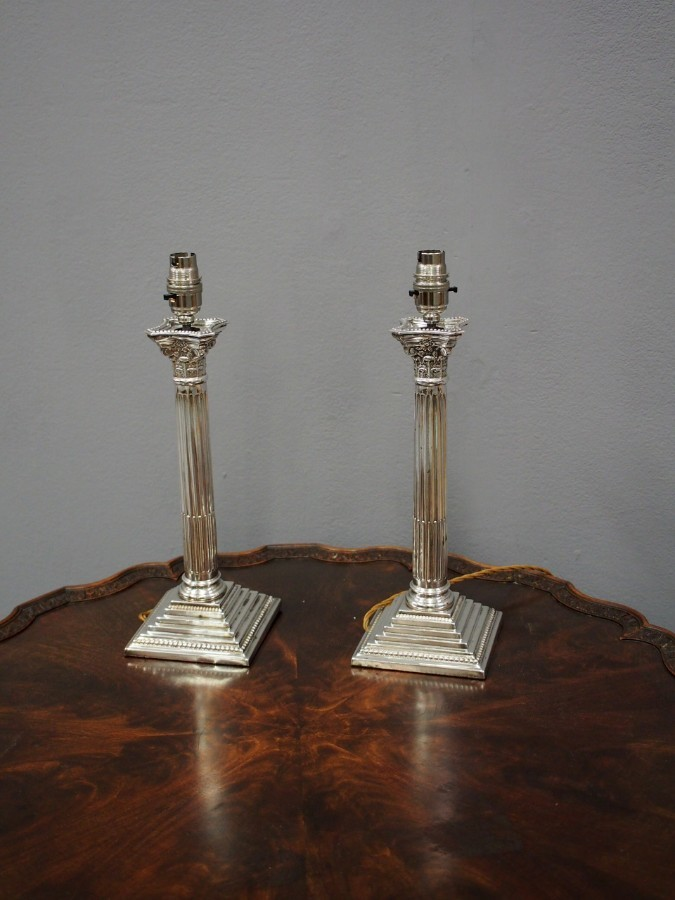 Antique Pair of Silver Plated Corinthian Lamps