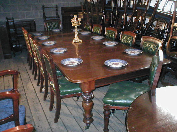 Mahogany Dining Table and a Set of 12 Victorian Dining Chairs