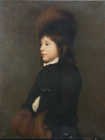 Antique Portrait of a young boy aged 11 in a black coat, fur hat and muff