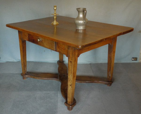 An antique continental walnut table