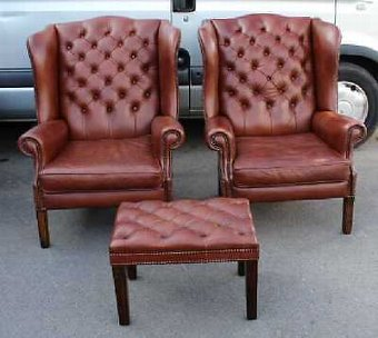 Antique Pair of Large Brown Leather buttoned Wing Back armchairs with matching Stool.