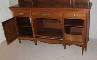 Antique 1920's Large decorative Carved Walnut Dresser with display rack and cupboards.