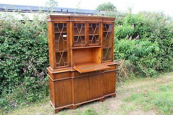 Antique Large 4 Door Breakfront Walnut Cabinet with Glazed Top Display sections.