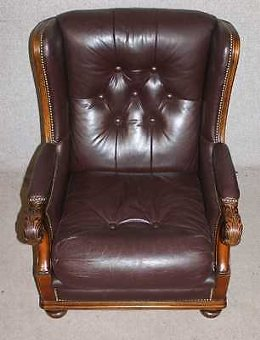 Antique Quality Handsome Conker Brown Leather Armchair with Carved solid Frame.