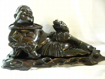 Antique A carved antique Chinese hardwood figure of Liu Hai reclining with a carved toad. - Item 3199