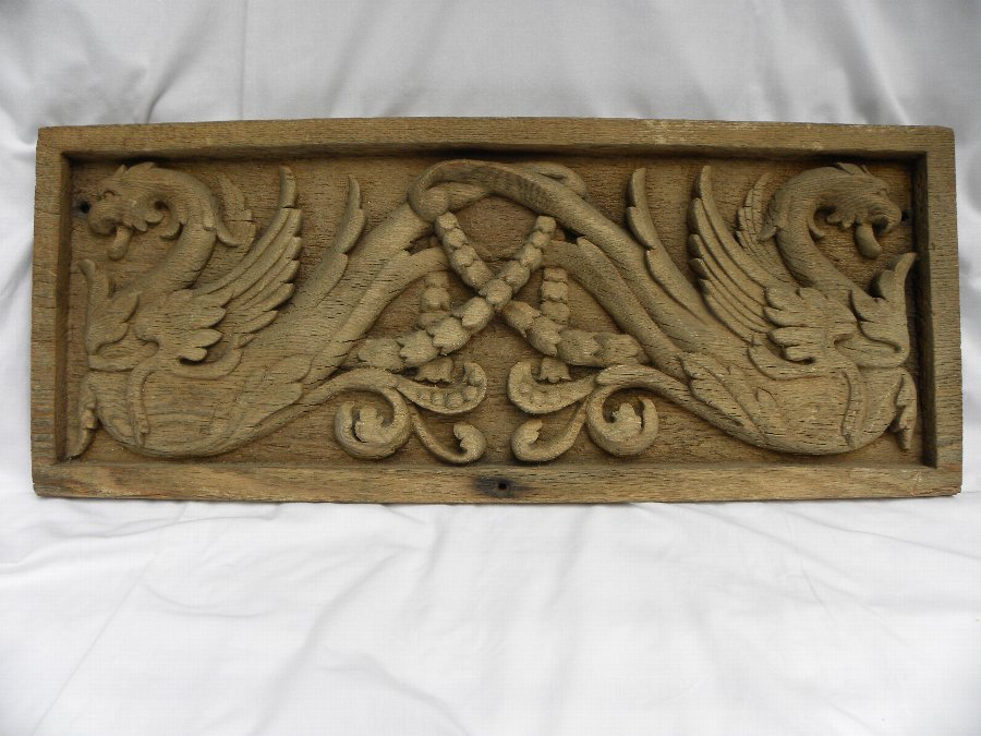 An antique carved wooden panel - Item 2088