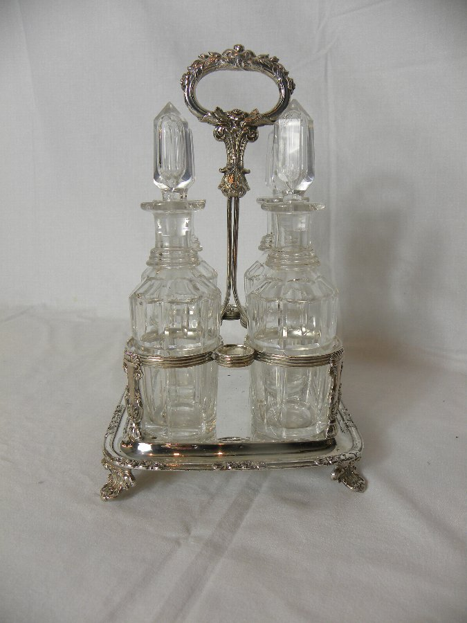 A four bottled silver plated Victorian condiment set - Item 3142