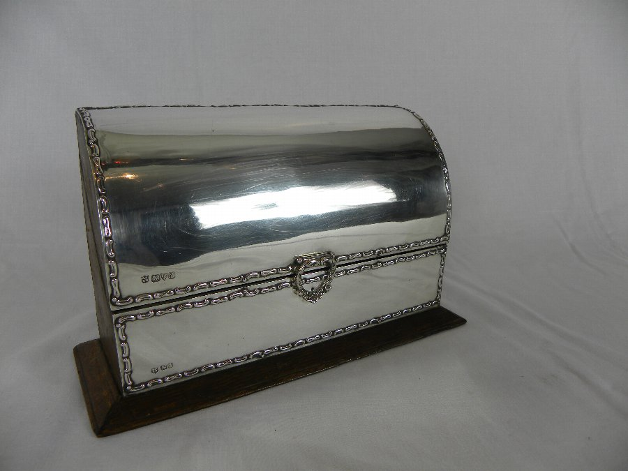 A leather bound stationary box with a hallmarked silver mount - Item 3151