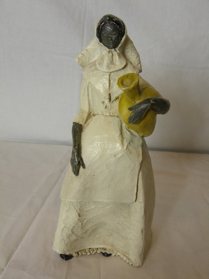 A hand painted plaster figure of a young lady - Item 3176