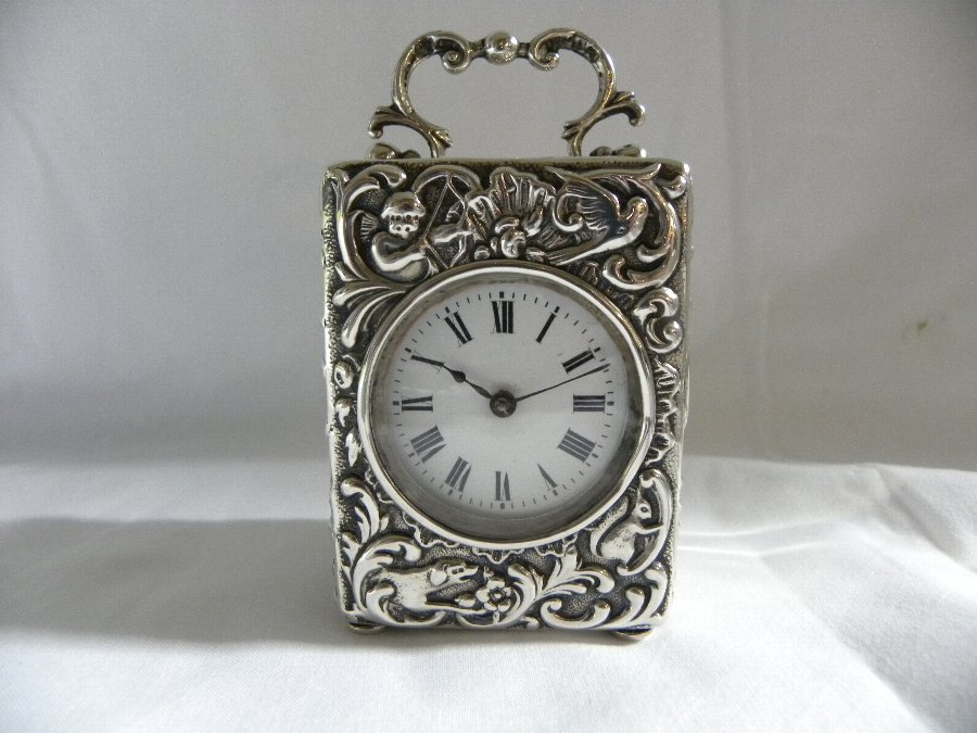 A silver hallmarked miniature carriage clock - Item 3194