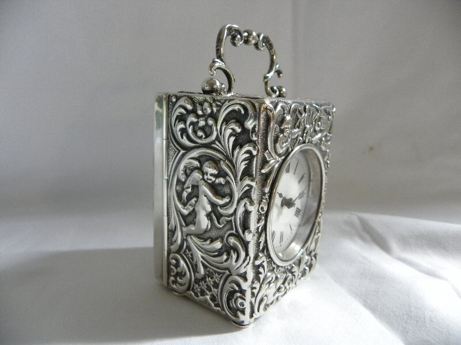 Antique A silver hallmarked miniature carriage clock - Item 3194