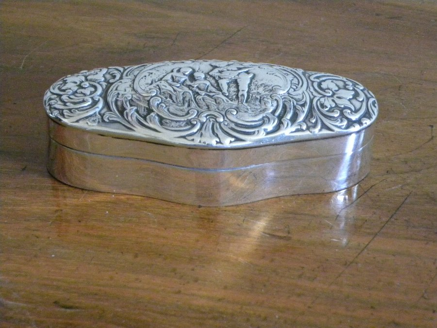 An oval HM silver embossed dressing table box - Item 3341