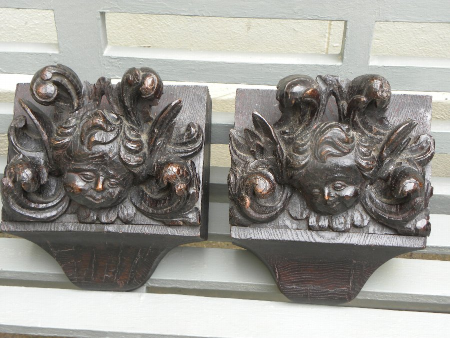 A pair of antique, hand carved, ebonised wall brackets - Item 3346B