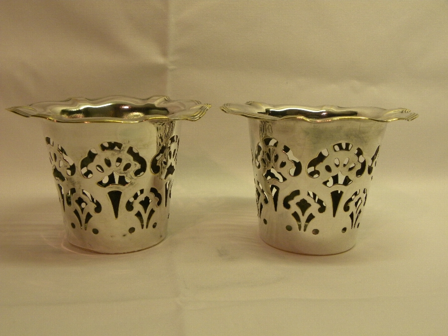 Pair of pierced silver coloured metal pots. - Item 650