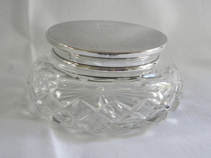 A cut crystal powder or trinket bowl with engine turned silver cover - Item 1021