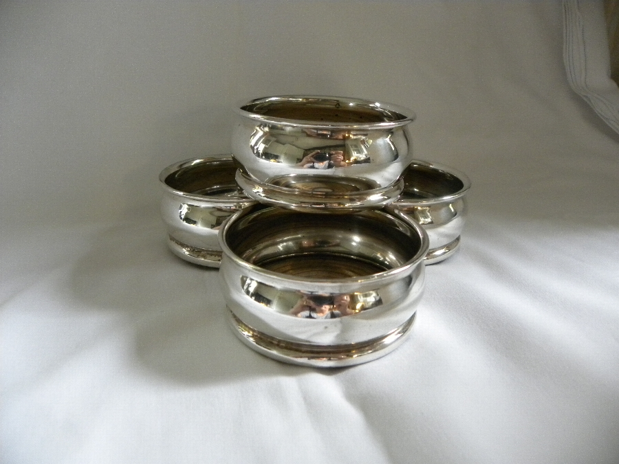 A set of four miniature electroplated coasters - Item 1096