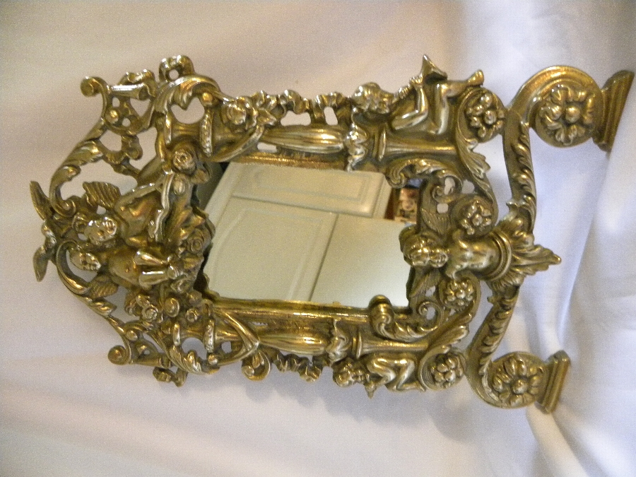 A gilded brass easel backed looking glass - Item 2017