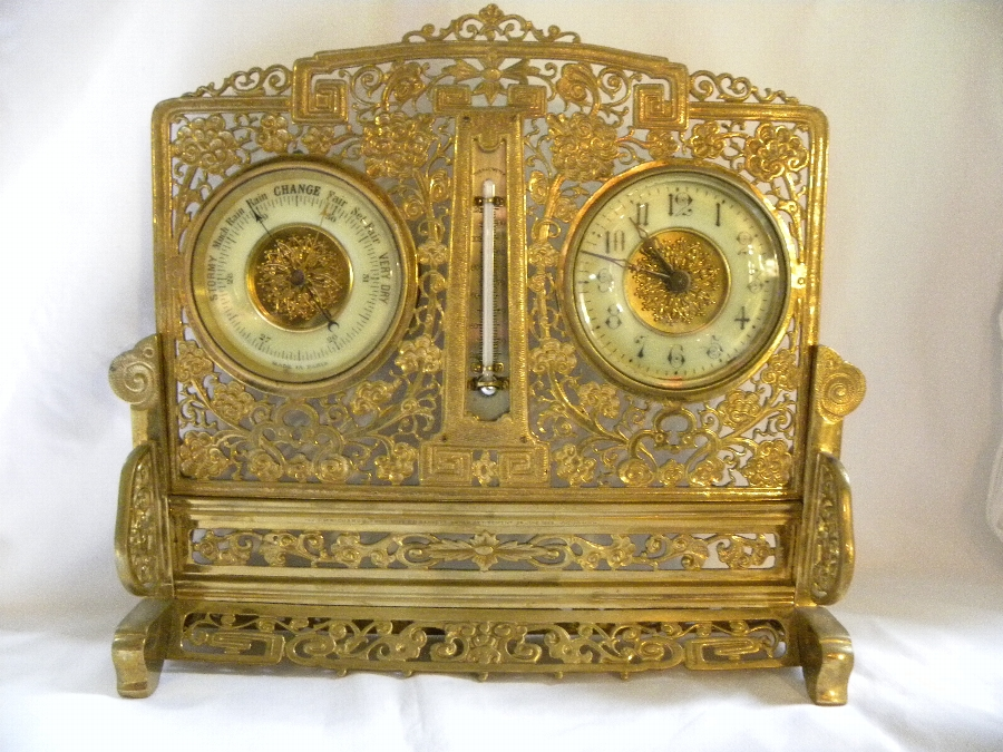 Late 19th Century pierced gilded brass clock and barometer set - Item 2026