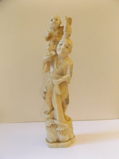 A Japanese Ivory Okimono of a Fisherman Holding a Boy on his Shoulders c1890 Meiji Period 21cm Hi...